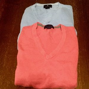 Two V neck long sleeve sweaters